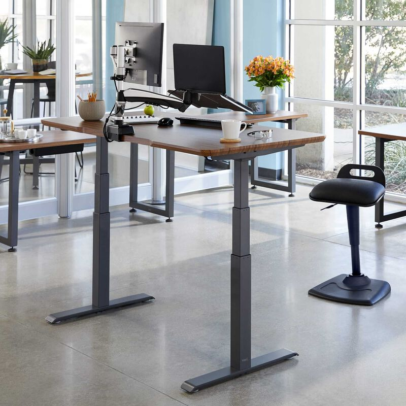 Electric Standing Desk 60x30 Darkwood in raised position at office image number null